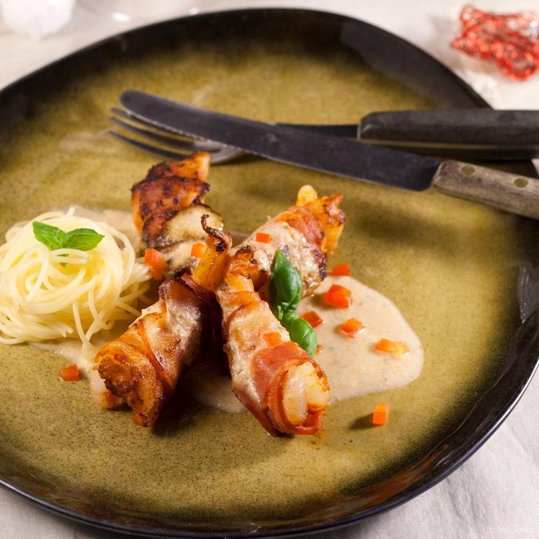 Scampi's in kruidenkaassausje en paprika, capellini